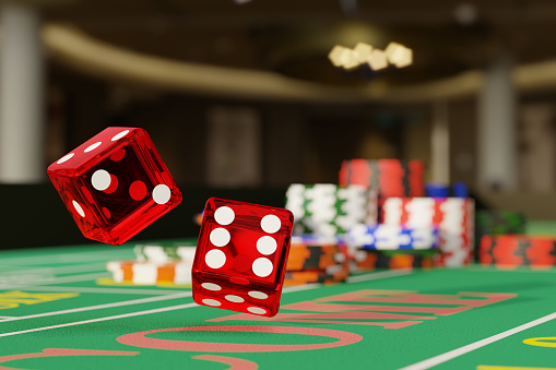 Detail shot of a pair of dice rolling down a craps table. Selective focus.Gambling concept. 3d illustration.