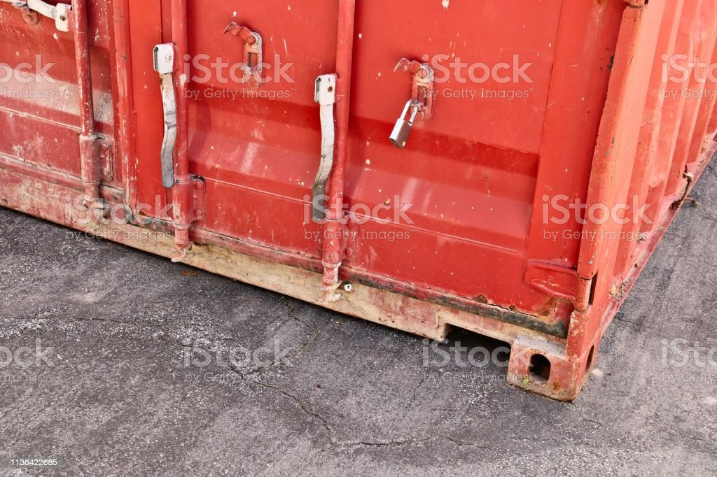 A close up shot of a red shipping container. Logistics concept image.