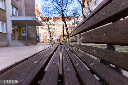 Close up shot of a wooden bench in a residental area in Dorcol, Beograd