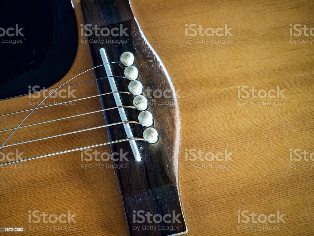 Close up shot of acoustic guitar with broken guitar strings stock photo