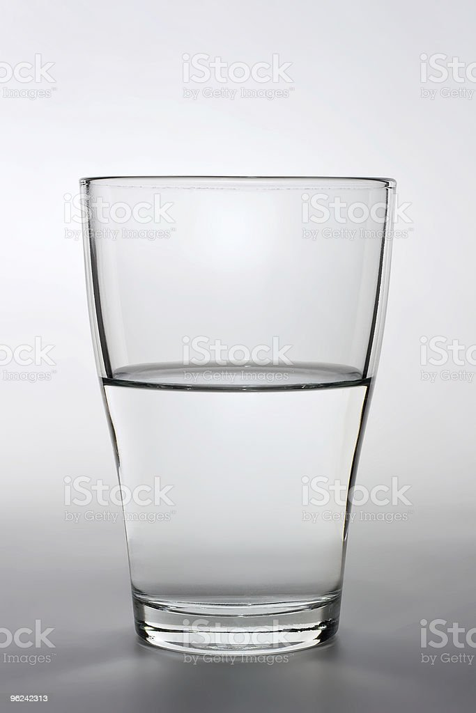 close up shot of an half filled water glass stock photo