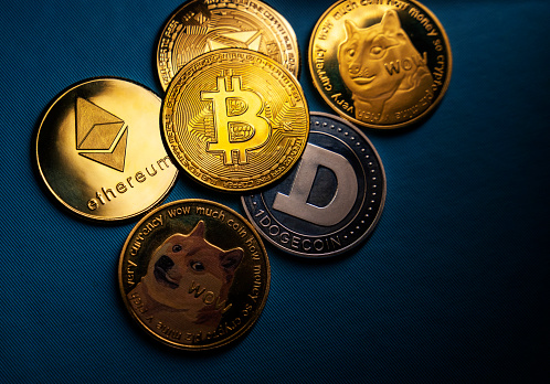 Antalya, Turkey - May 21, 2021: Close up shot of Bitcoin and alt coins cryptocurrency