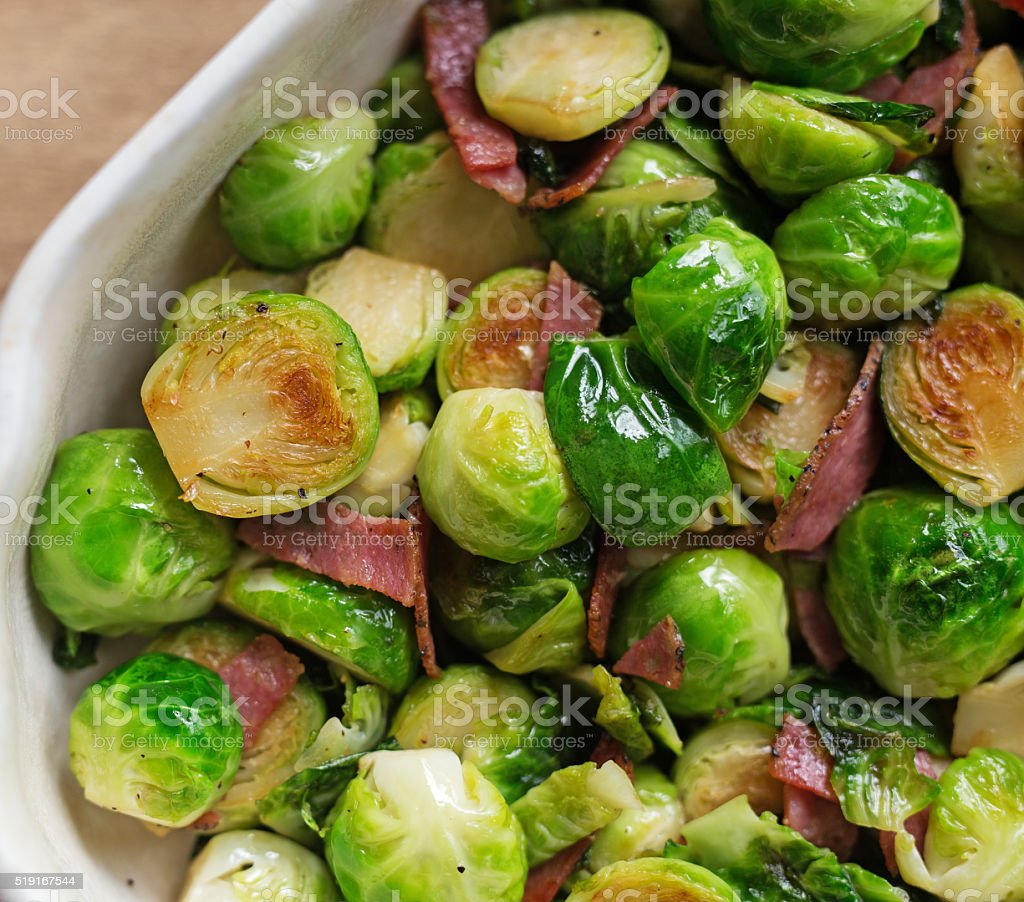 Close up shot of Brussels sprouts with ham. stock photo