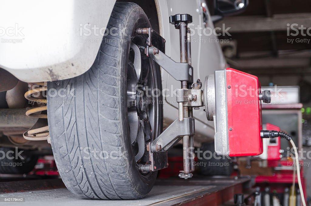 Close up shot of car wheel centering machine adjustment shallow stock photo