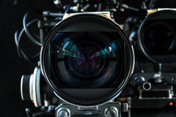 Close up shot of cinema lens with lot of equipment for filming cinema or movie in a division filming. Cinema lens. Photo lens. stock photo