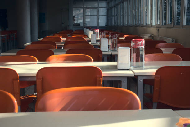 Close up shot of empty seats of a cafeteria after the closing of schools stock photo