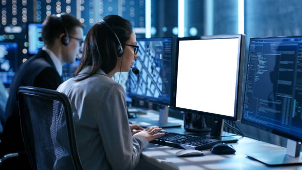 Close up Shot of Female working in a Technical Support Team Gives Instructions with the Help of the Headsets. She Works With White Screen Isolated. Good for Template. stock photo