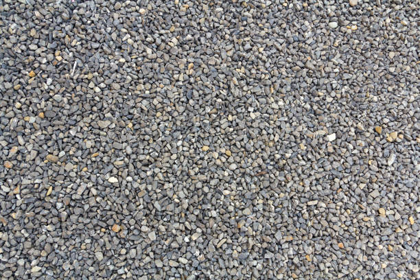 Close up shot of gravel rocks pebble stones as a background stock photo