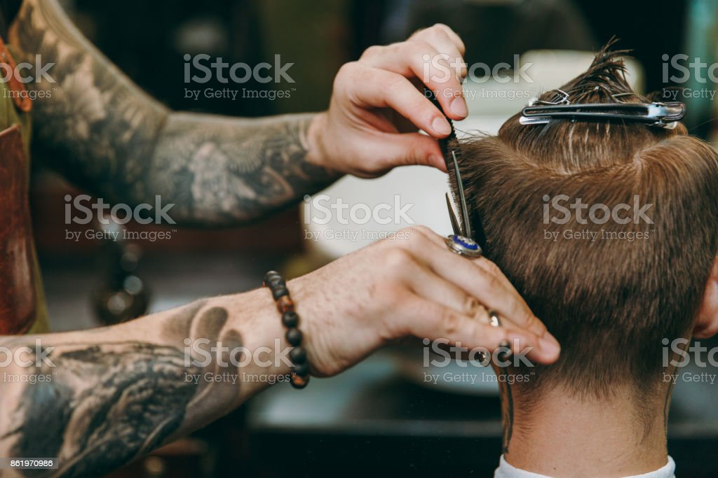 Close Up Shot Of Man Getting Trendy Haircut At Barber Shop Male