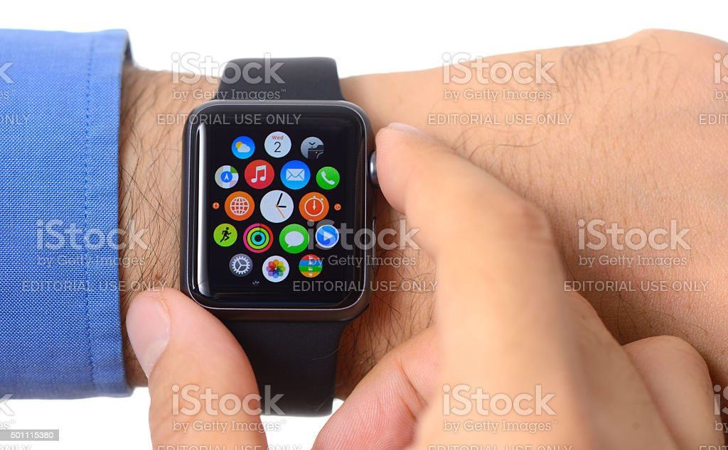 Close up shot of man using Apple Watch Sport stock photo