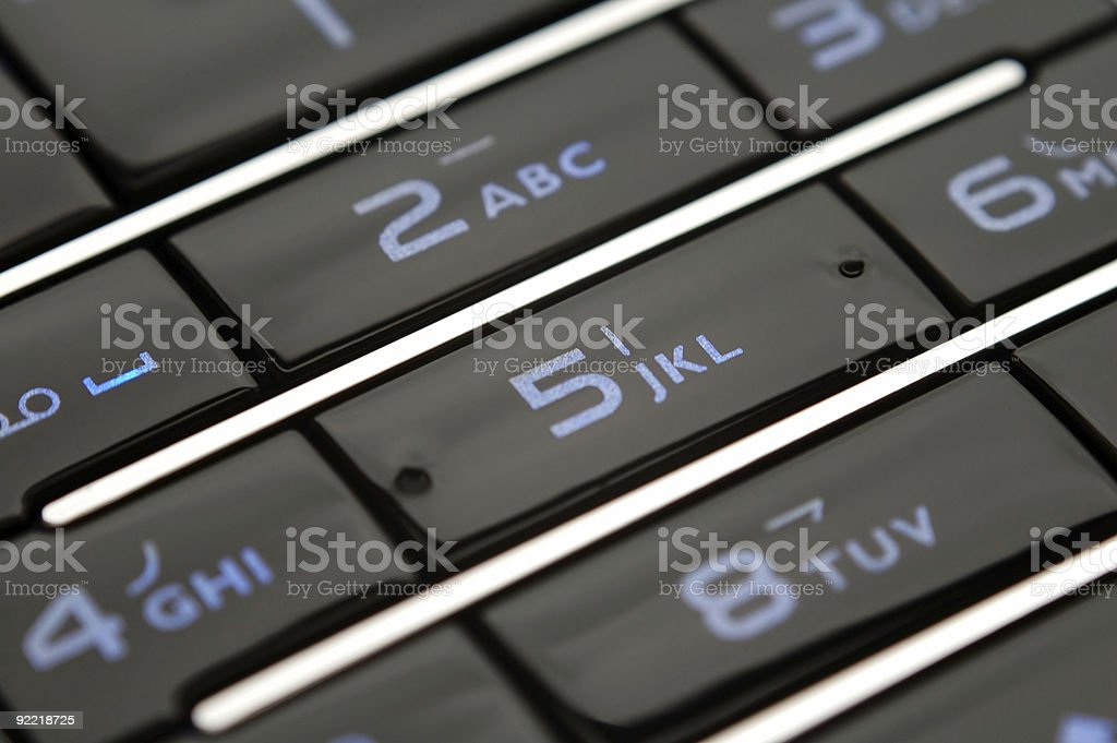 Close up shot of mobile keypad under light royalty-free stock photo