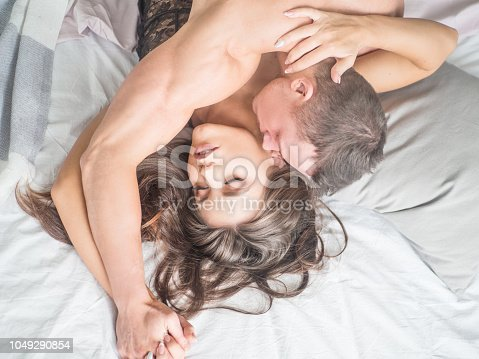 528422658 istock photo Close up shot of passionate young couple having sex on bed. 1049290854