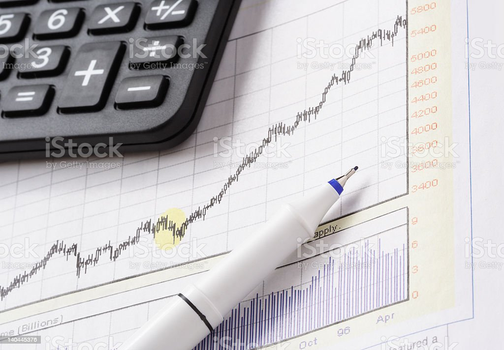 close up shot of pen on stock chart royalty-free stock photo