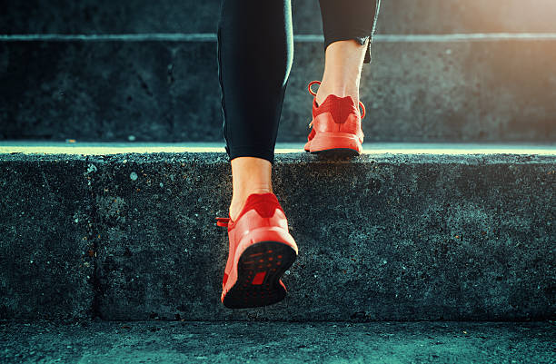 close up shot of runner's shoes - staircase stock photos and pictures