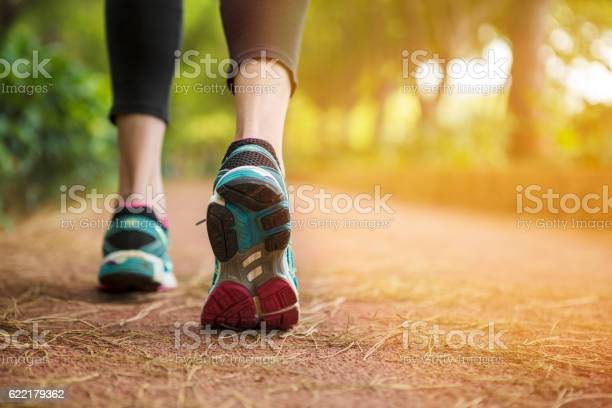 Woman running on a path.close up.