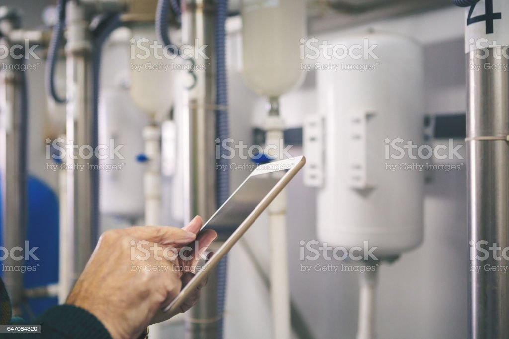 Close up shot of technician using tablet pc stock photo