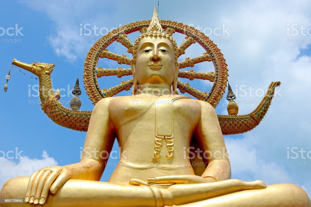 A close up shot of the large Buddha Statue found at the Wat Phra Yai temple near Bangrak beach in Koh Samui, Thailand. - Royalty-free Antigo Foto de stock