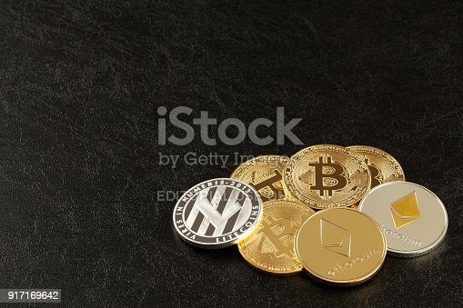 Tokyo,Japan-february 11 ,2018: Studio shot of  ethereum, litecoins, Bitcoin, on black background.Digital virtual currency