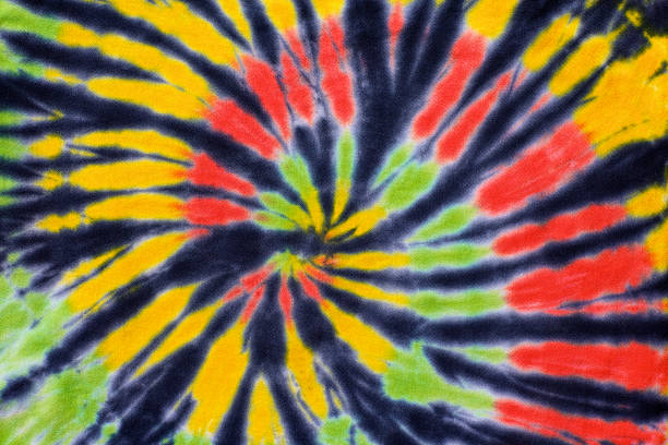 close up shot of tie dye fabric texture background - reggae stok fotoğraflar ve resimler