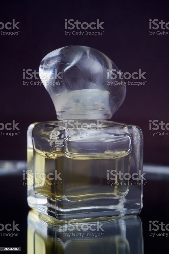 Close Up Shot Of Traditional Luxury Perfume In A Beautiful Handmade Clear Crystal Glass Jar Bottle On Black Background Antique Style, Text Space stock photo
