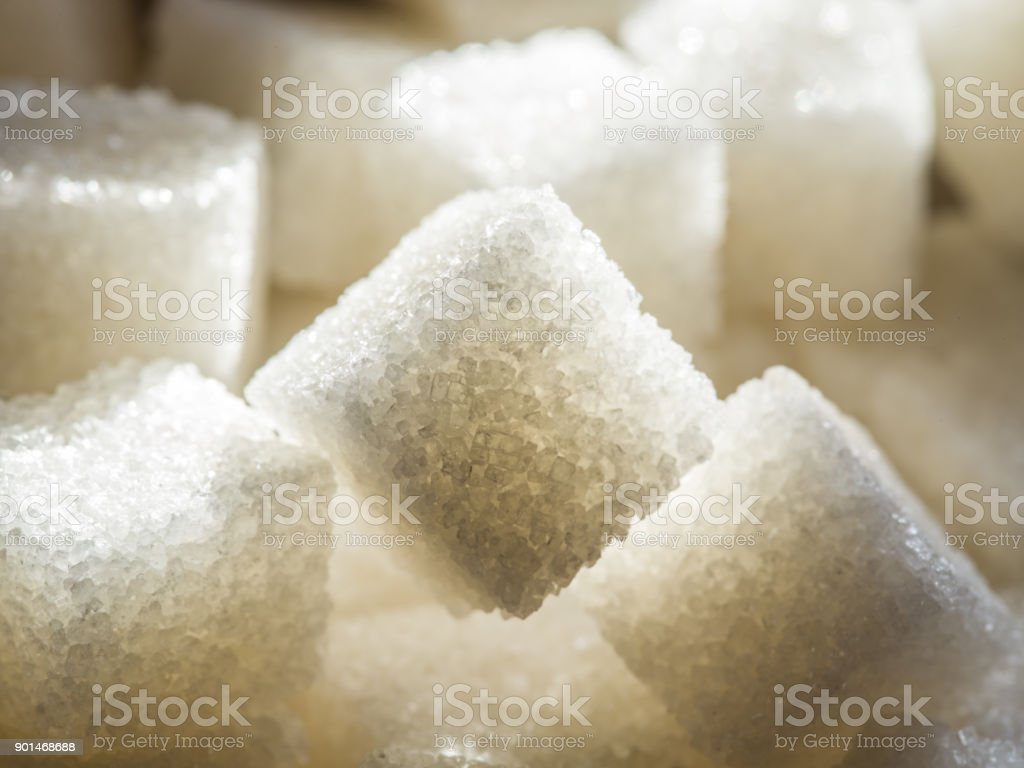 Close up shot of white refinery sugar. stock photo