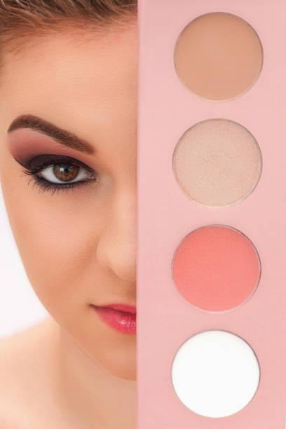 close up shot of young beautiful model with set of colored powders hiding her face - vlad models стоковые фото и изображения