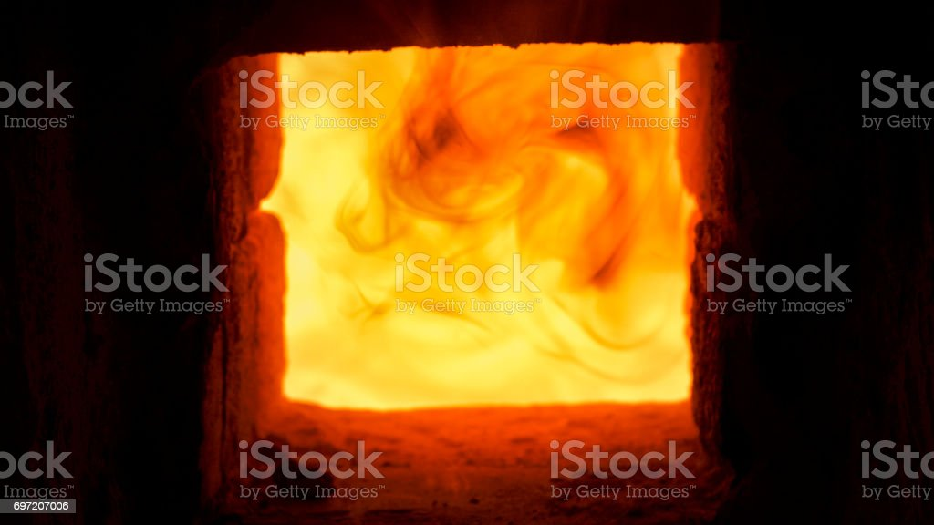 Close -up shot that A hot flame is burning in a porcelain kiln. stock photo