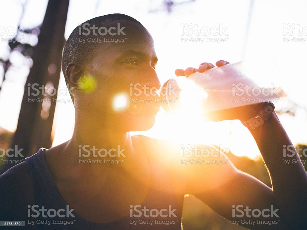 Close up shot with lens flare of afro-american athlete stock photo