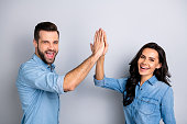 istock Close up side profile photo amazing she her he him his couple lady guy clapping hands arms teamwork bonding good job work wear casual jeans denim shirts outfit clothes isolated grey background 1137310874