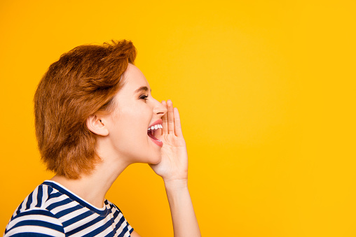 istock Close up side profile photo beautiful amazing she her lady sending sharing spreading rumours people wear casual striped white blue t-shirt outfit clothes isolated yellow bright background 1145167852