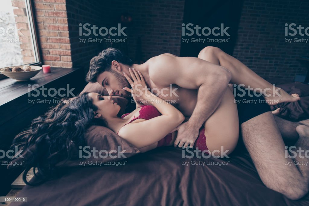 Close up side profile photo of two people wife husband laying on red...