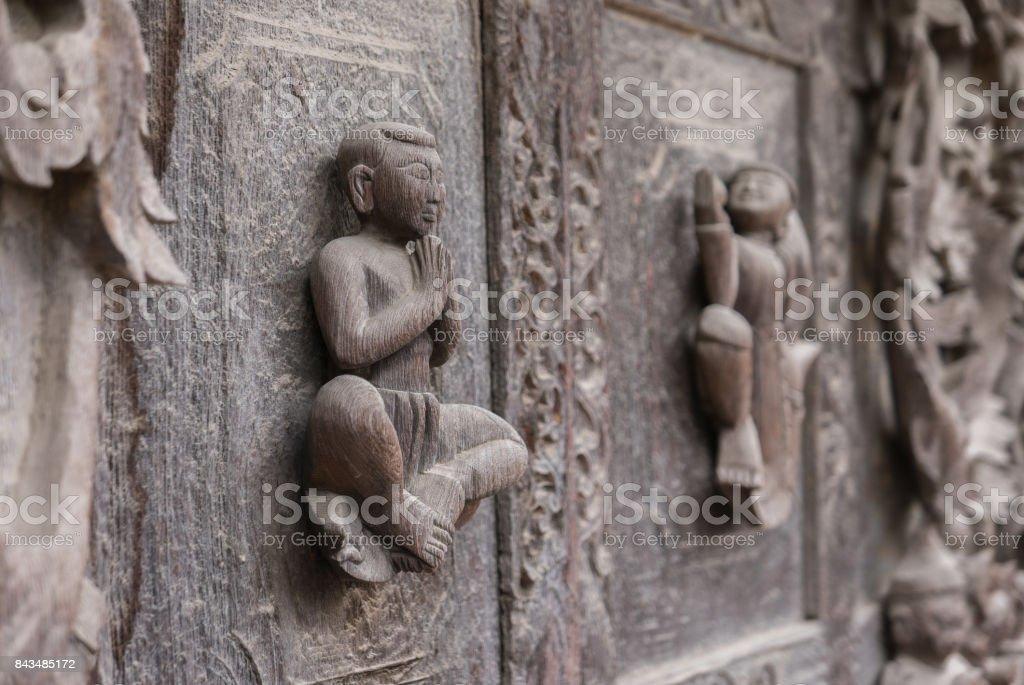 Close Up Side View of Praying Figure on Exterior Wall, Shwenandaw Monastery, Mandalay, Myanmar (Burma) stock photo