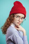 istock close up side view portrait of ginger street girl with red knitted cap 1127487152