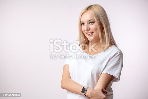 istock close up side view shot of awasome blond girl in white T-shirt wearing watch 1126450864