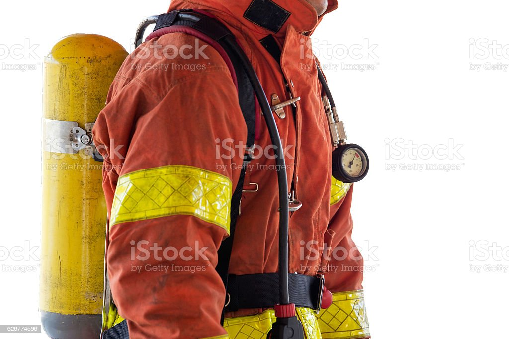 close up single fireman in fire fighting protection suit - foto de acervo