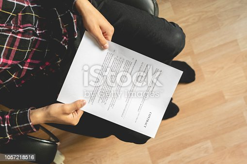 istock close up sitting businessman looking for contract details in armchair g 1057218516