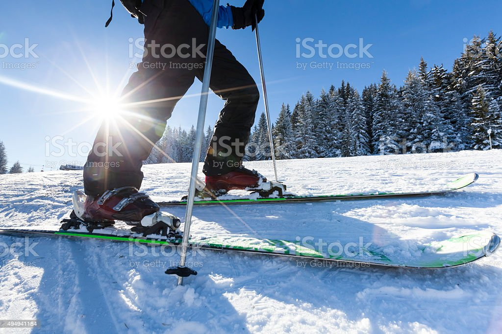 Close up skier ski shoes and snow stock photo