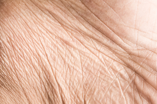 istock Close up skin texture with wrinkles on body human 951386284
