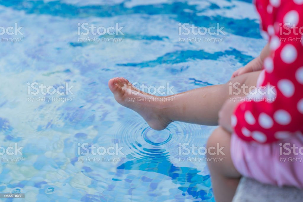 Close up small leg kid wet water. royalty-free stock photo