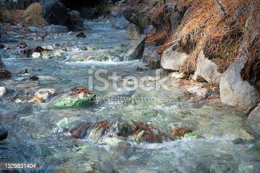 istock Close up small waterfall from hot spring running down in a warm stream in Sainokawara Park hot spring ,Kusatsu Onsen, Gunma,Japan. 1329831404