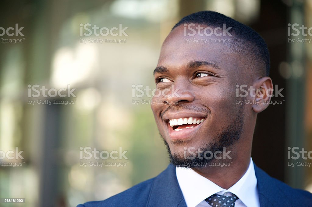 Close up smiling business man in the city stock photo