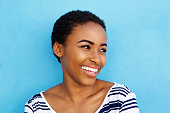 istock Close up smiling young black woman looking away 857924826