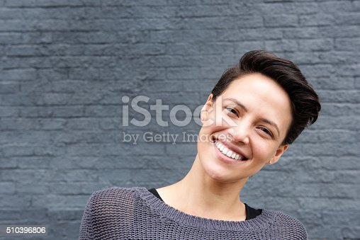 istock Close up smiling young woman with short hair 510396806