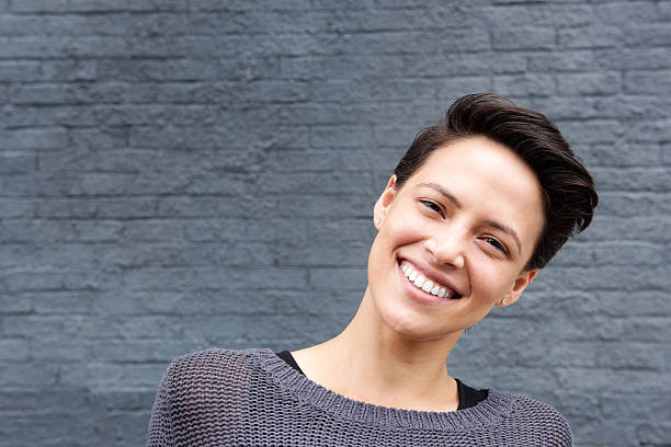 Close up smiling young woman with short hair stock photo