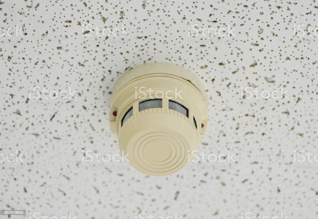 Close up Smoke detector on the ceiling stock photo