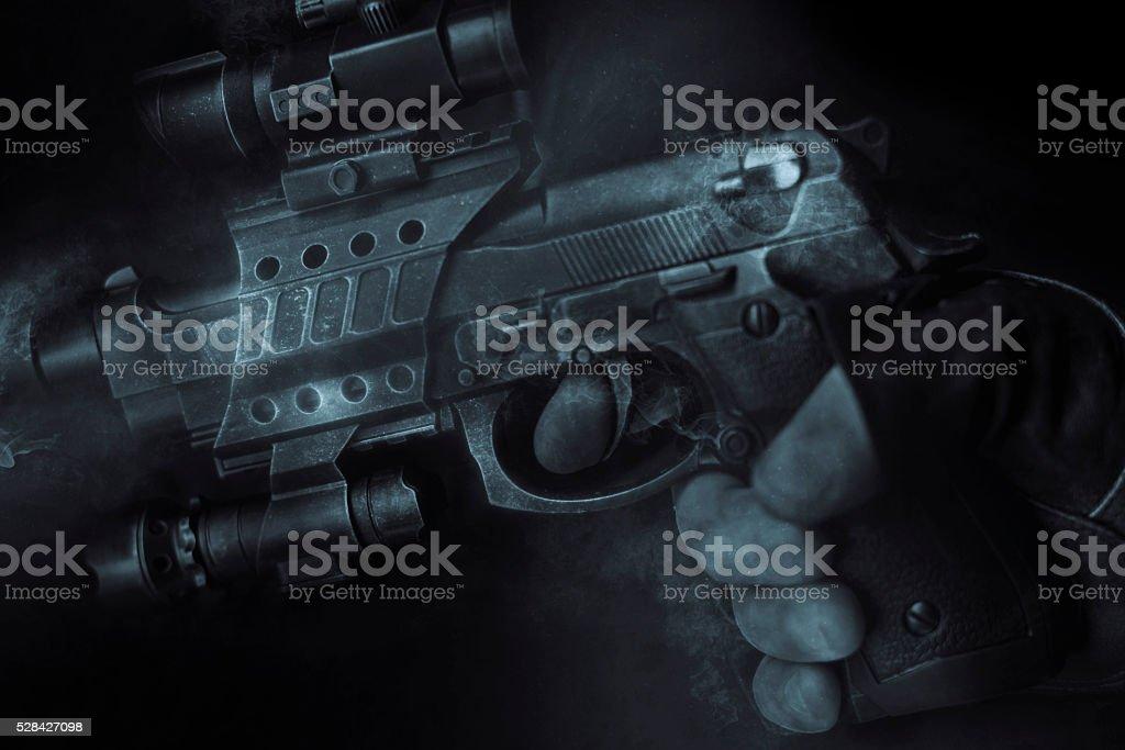 close up smokey gun stock photo