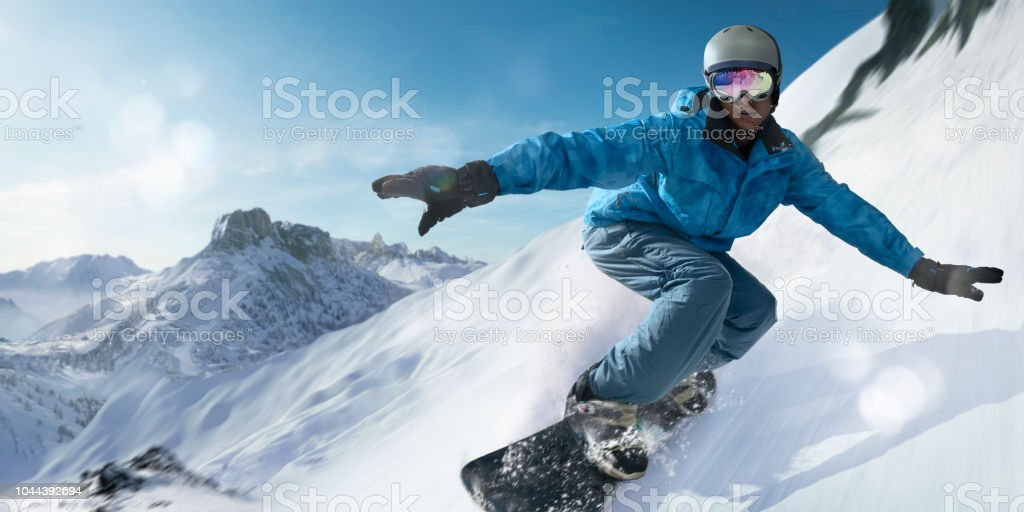 Close Up Snowboarder Moving At High Speed Down Mountain Slope stock photo