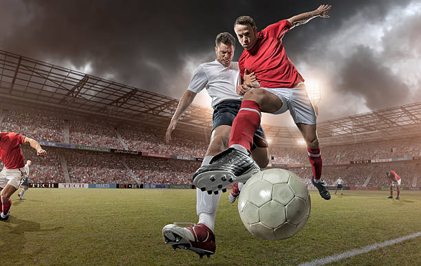 close up soccer action - soccer player stock photos and pictures