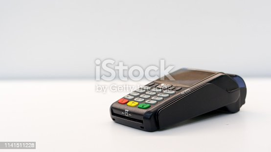 close up soft focus credit card reader  machine at white background table for  business financial about contactless payment concept