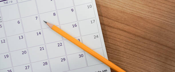 close up soft focus on pencil over calendar 2018 at office desk with top view concept - calendar imagens e fotografias de stock
